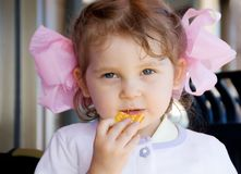 Little girl with snack Royalty Free Stock Photo