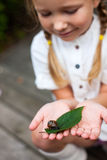 Little girl and snail stock photo