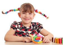 Little girl with snail plasticine figure Stock Image