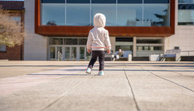 Little girl with sneakers and hoodie standing Royalty Free Stock Images