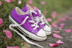 Little girl sneakers shoes. Outdoor portrait of a little girl sneakers shoes Royalty Free Stock Photography