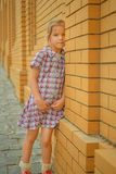 Little girl snear brick wall Royalty Free Stock Photography