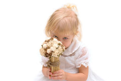 Little girl sniffing flowers Royalty Free Stock Images