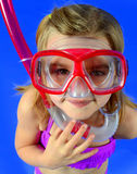 Little Girl with Snorkel. Little girl in purple bikini with a snorkel and scuba mask Royalty Free Stock Images