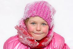 Little girl  in snow . Royalty Free Stock Photo