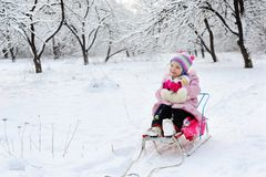 Little girl in the snow Stock Images