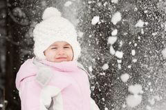 Little girl and snow Royalty Free Stock Photos