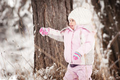 Little girl and snow Royalty Free Stock Image