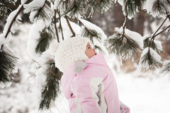 Little girl and snow Stock Image