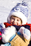 Little girl on the snow Royalty Free Stock Images