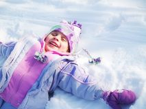 Little girl snow angel Royalty Free Stock Photo