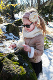 A little girl with snow in hand Royalty Free Stock Image