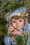 Little girl Snow Maiden on a background of the Christmas tree Stock Photography