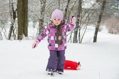 little girl in snow Stock Photos