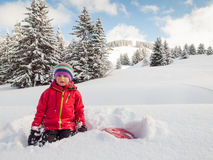 Little girl in snow with sledge Royalty Free Stock Photo