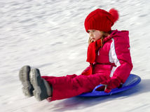 Little girl with snow sleds Stock Photo