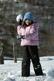 Little girl with snowball Stock Photography