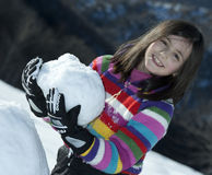 Little girl with snowball Stock Photo