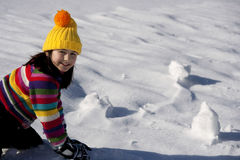 Little girl with snowball Royalty Free Stock Photo