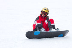 Little girl snowboarder in French Alps Stock Images