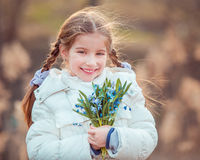 Little girl with a snowdrops Royalty Free Stock Photo