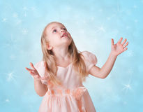 Little girl with snowflakes Royalty Free Stock Photos