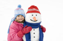 Little girl and snowman royalty free stock images