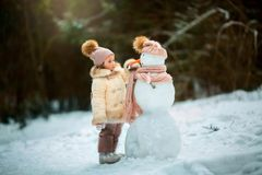 Little girl with snowman Royalty Free Stock Image