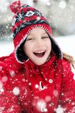 Little girl and snowman Stock Image