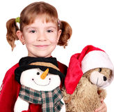 Little girl with snowman and teddy-bear Stock Photography