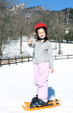 Little girl with snowshoes Royalty Free Stock Images