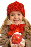 Little girl with snowy christmas bauble Royalty Free Stock Photo