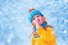 Little girl in snowy park Royalty Free Stock Photo