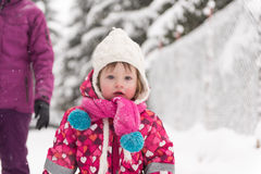 Little girl at snowy winter day Stock Photography