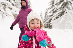 Little girl at snowy winter day Stock Photo