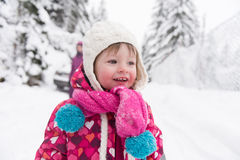 Little girl at snowy winter day Royalty Free Stock Photo
