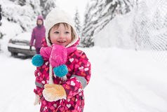 Little girl at snowy winter day Royalty Free Stock Images
