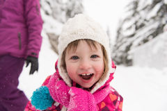 Little girl at snowy winter day Royalty Free Stock Photography
