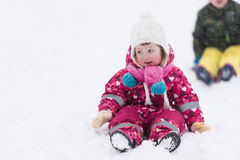 Little girl at snowy winter day Royalty Free Stock Photos