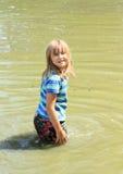 Little girl soaking wet in water Stock Photos
