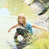 Little girl soaking wet in water Stock Photography