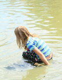 Little girl soaking wet in water Royalty Free Stock Image