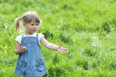 Little girl with soap bubbles Stock Photo