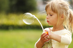 Little girl with soap bubbles Royalty Free Stock Photos