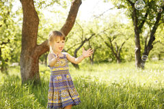 Little girl with soap bubbles Royalty Free Stock Images