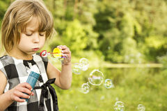 Little girl with soap bubbles Royalty Free Stock Photo