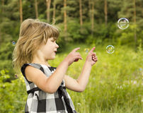 Little girl with soap bubbles Stock Photography