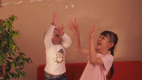 Little girl and soap bubbles stock video