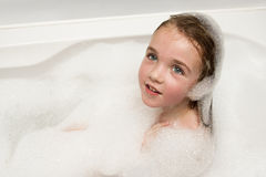 Little girl in soap foam Royalty Free Stock Images