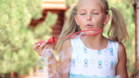 Little girl with soap funny kid sun bubbles summer playful bright. Little girl with soap bubbles sun summer bright vacation playful funny kid stock footage